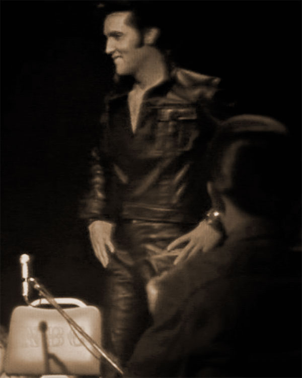 Elvis and his NBC chair, 1968