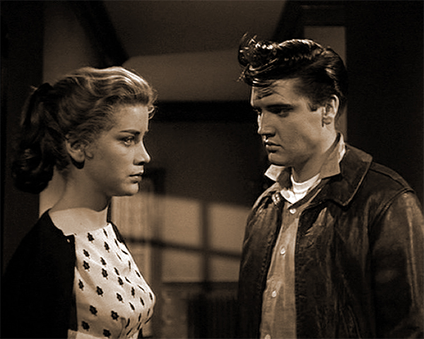 "Nellie (Dolores Hart) and ""George"" (Elvis Presley) outside of Room 205 in KING CREOLE"