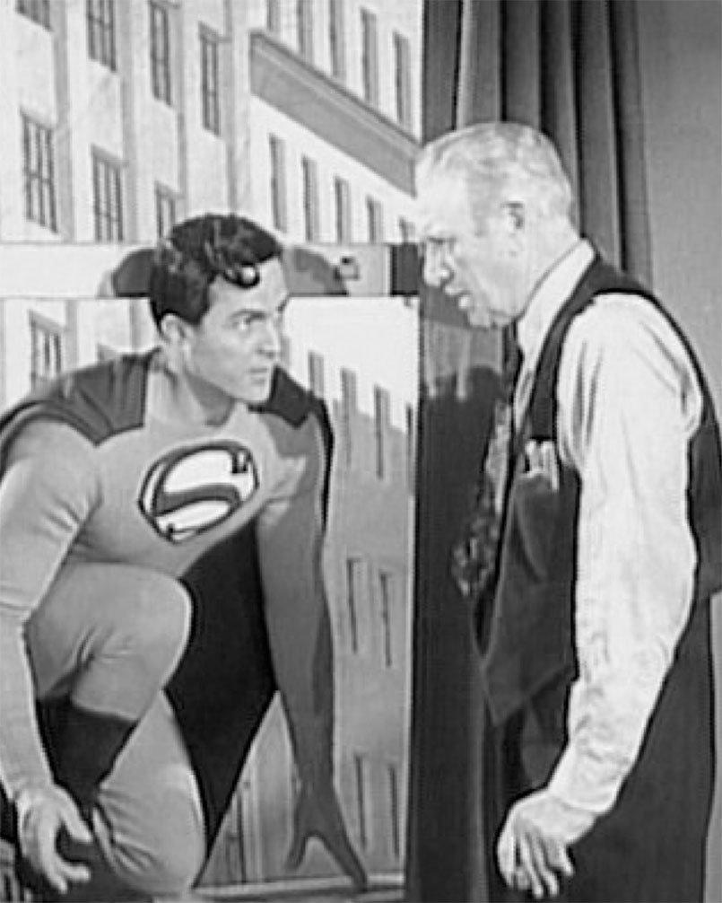 Superman (Kirk Alyn) drops in on Perry White (Pierre Watkin) in SUPERMAN (1948)
