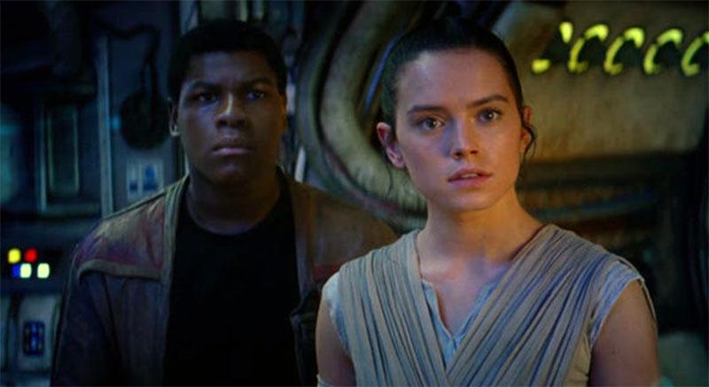 John Boyega is Finn and Daisy Ridley is Rey in STAR WARS: THE FORCE AWAKENS (2015)