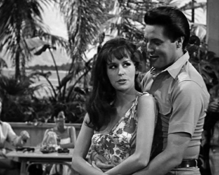 Marianna Hill and Elvis Presley performing a duet in PARADISE, HAWAIIAN STYLE (Paramount Pictures, 1966)
