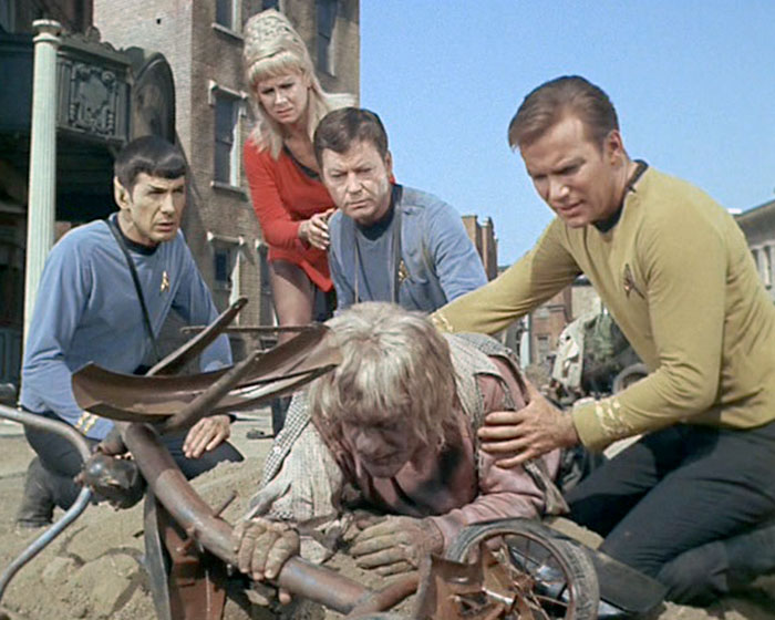 "Spock (Leonard Nimoy), Rand (Grace Lee Whitney), McCoy (DeForest Kelley), and Kirk (William Shatner) attempt to comfort an infected grup in STAR TREK: ""Miri"" (Desilu, 1966)"