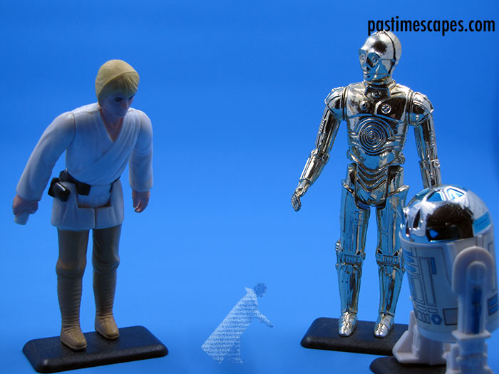 """Help me, Obi-Wan Kenobi. You're my only hope."" Luke Skywalker, See-Threepio (C-3PO), and Artoo-Detoo (R2-D2), Kenner, 1977. (From the author's collection.)"