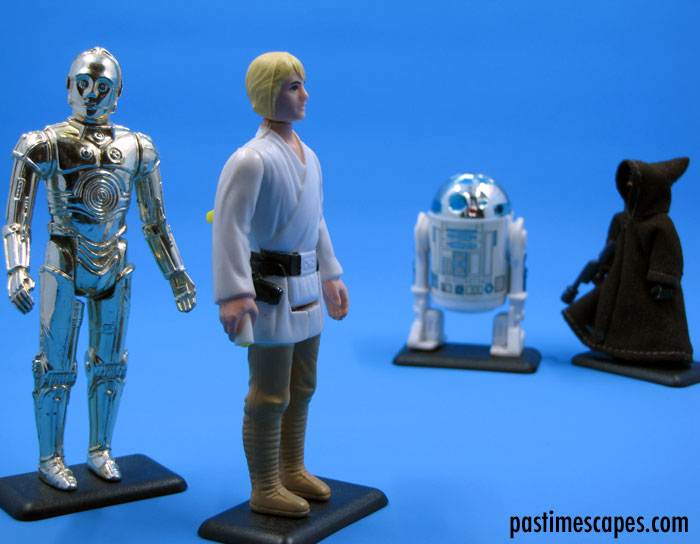 """Why I should stick my neck out for you is quite beyond my capacity."" See-Threepio (C-3PO), Luke Skywalker, Artoo-Detoo (R2-D2), and a Jawa, Kenner, 1977. (From the author's collection.)"