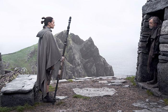 Daisy Ridley is Rey and Mark Hamill is Luke in THE LAST JEDI (2017, Walt Disney)